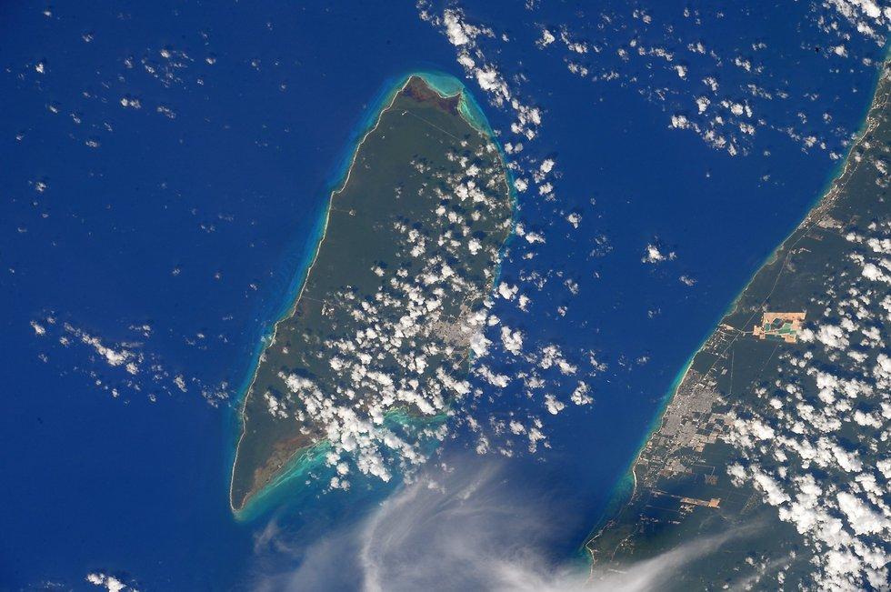 """האי קוסומול במקסיקו  (צילום: רנדי ברסניק, נאס""""א)"""