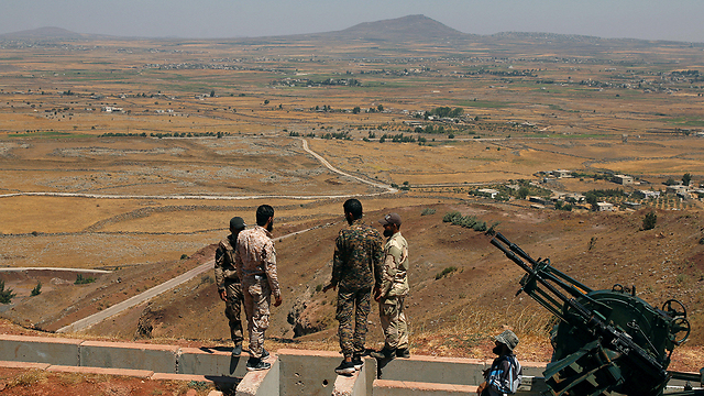 Syrian rebel forces near Golan Heights (Photo: Reuters)