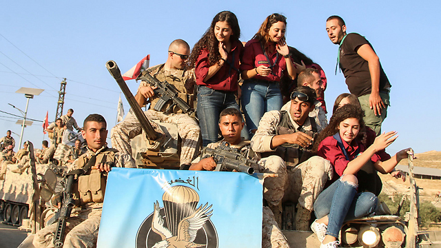 Lebanese soldiers and civilians celebrate victory (Photo: AFP) (Photo: AFP)