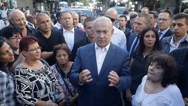 PM during visit to south Tel Aviv (Photo: Shaul Golan) (Photo: Shaul Golan)