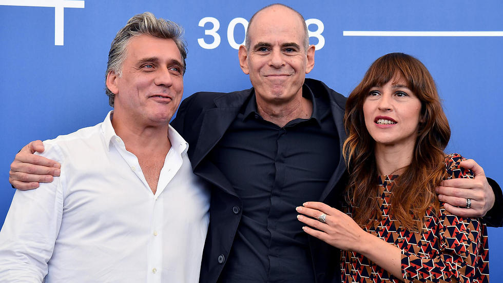 Director Samuel Maoz, center, with Foxtrot stars Lior Ashkenazi, left, and Sarah Adler, right (Photo: EPA)