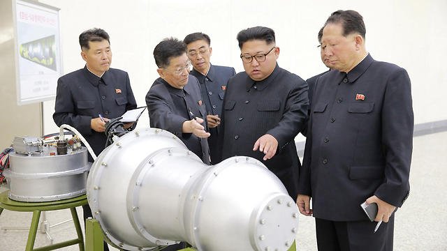 Kim and nuclear scientists (Photo: Reuters)