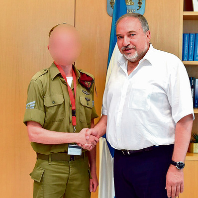With Defense Minister Avigdor Lieberman. 'It's a great honor, but the circumstances make me sad'