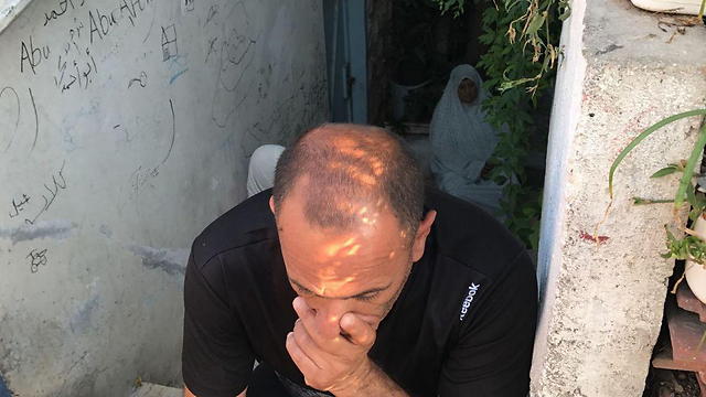 Muhammad Shamasna after outside his home as he was being evicted