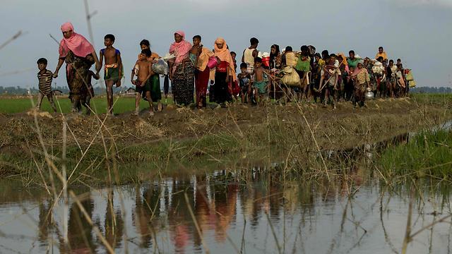 """הנדידה לבנגלדש. """"יש די מידע כדי להעמיד את המפקדים לדין"""" (צילום: AFP) (צילום: AFP)"""