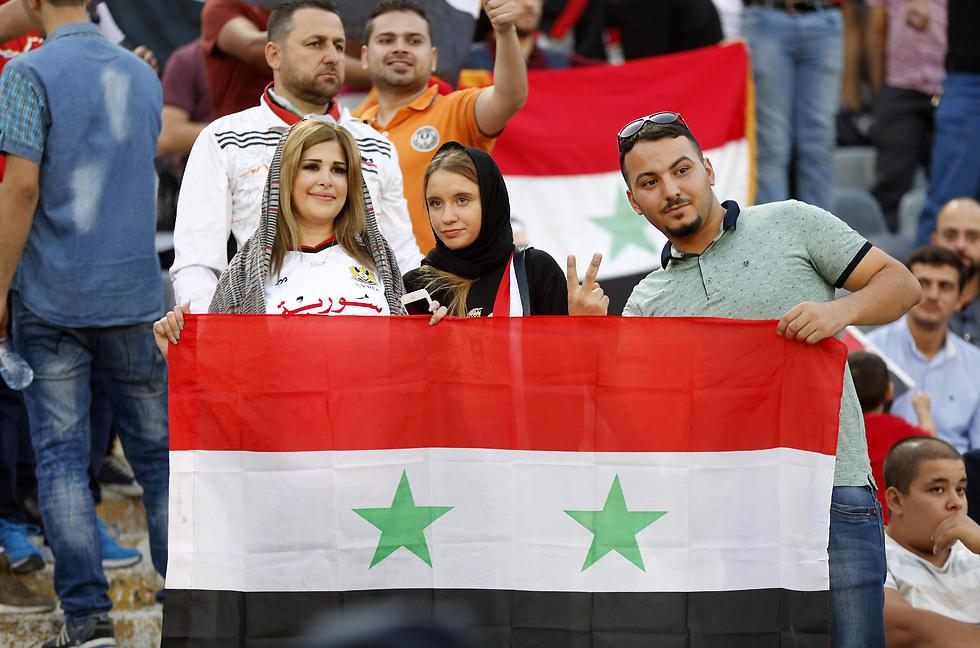 ממשיכים לחלום. אוהדי נבחרת סוריה (צילום: AFP) (צילום: AFP)