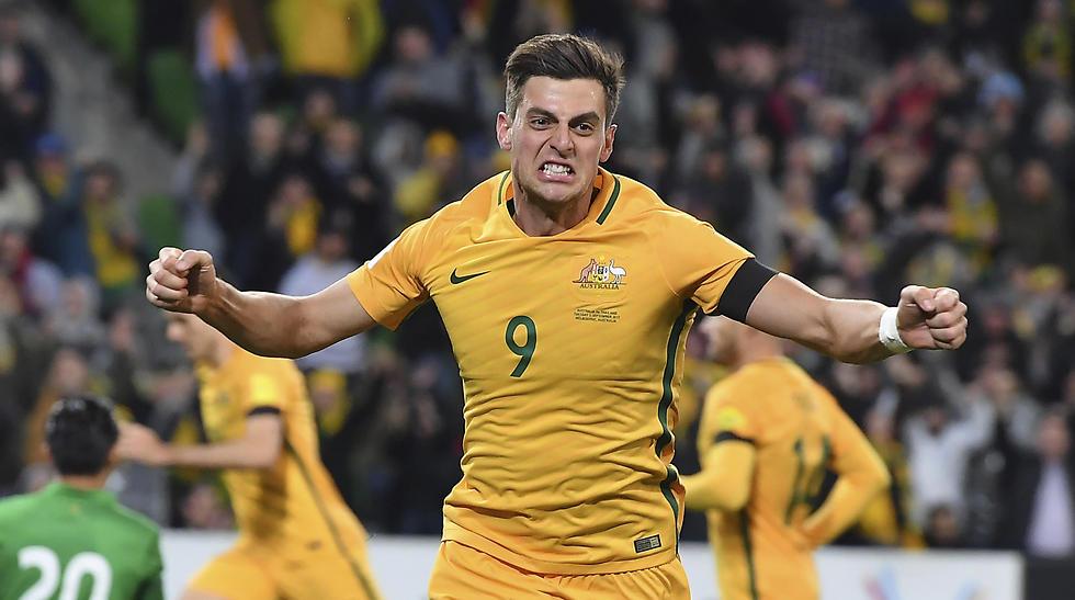 האוסטרלי טומי יוריץ' חוגג (צילום: AP) (צילום: AP)