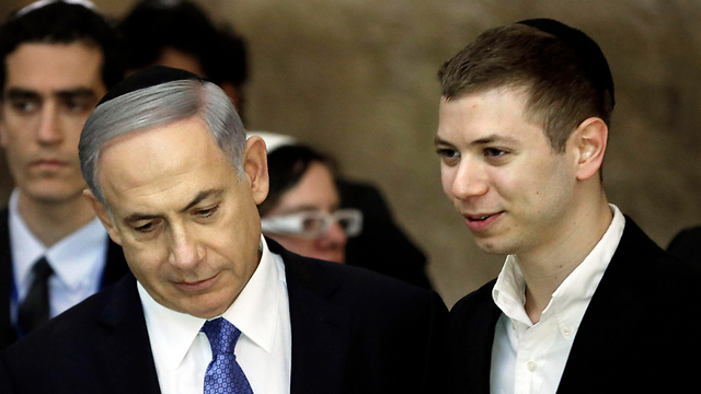 PM Netanyahu and his son, Yair (Photo: AFP)
