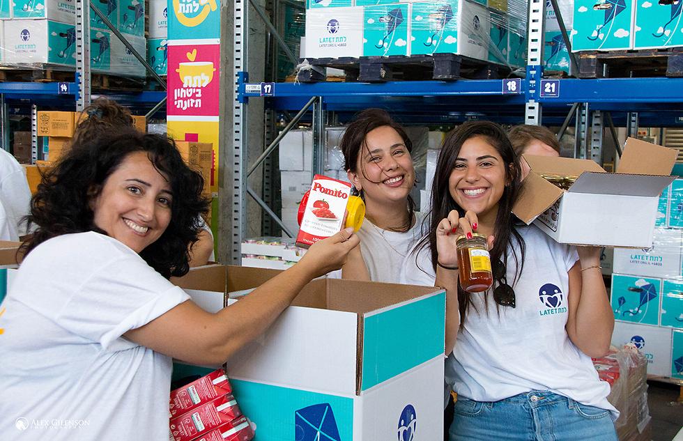 Latet volunteers prepare food packages