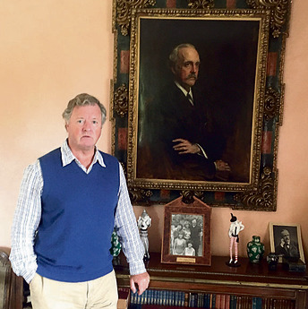 Lord Roddy Balfour with his famous relative's portrait. 'In the last 20 years, people have often been saying to me, 'It's your Balfour declaration that's caused all the problems in the Middle East'' (Photo: Yaniv Halily)