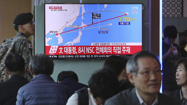 South Koreans watch reports of the launch (Photo: AP)