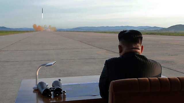 Kim supervising the launch of a ballistic missile  (Photo: AFP)