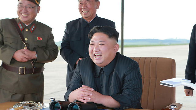 North Korean leader Kim watching a ballistic missile test (Photo: AFP)