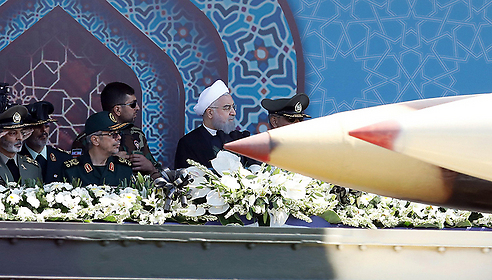Hassan Rouhani, shown behind the missile