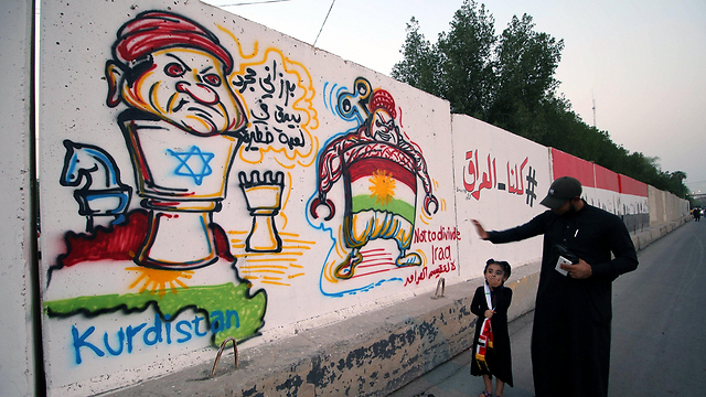 Graffiti in Basra, Iraq accusing Kurds of being pawns of Israel (Photo: EPA)