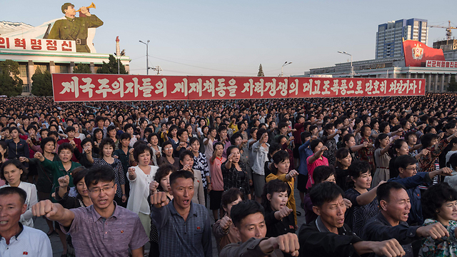 North Koreans in support rally for Kim (Photo: AFP)