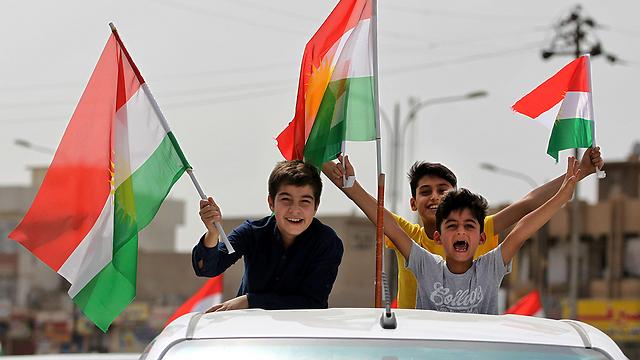כורדים חוגגים את משאל העם (צילום: AFP) (צילום: AFP)