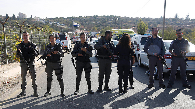 Security forces in Har Adar. Between 'a renewal of the peace process' and 'a proper Zionist response,' both the Left and the Right are sinking deeper into their own mud (Photo: AP)