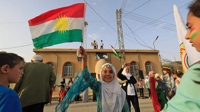 Kurds in Syria celebrate Iraqi Kurdistan independence referendum (Photo: AFP)