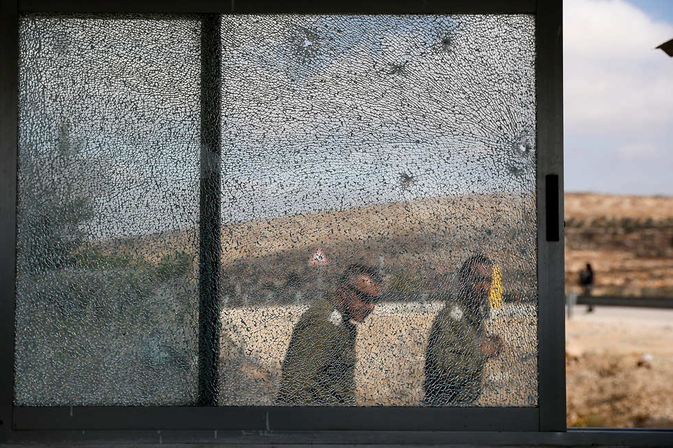 Scenes of the Har Adar attack (Photo: EPA) (Photo: EPA)