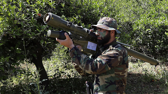 A Hezbollah militant near the Israeli-Lebanese border (Photo: AFP) (Photo: AFP)