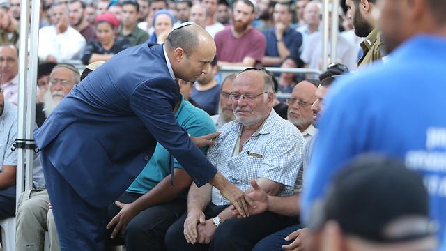 Education Minister Naftali Bennett pays his respects (Photo: Amit Shabi)