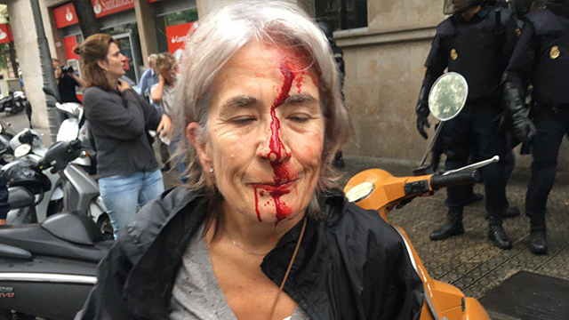 Woman injured in clashes in Catalonia