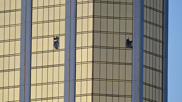 The windows smashed by Paddock in the shooting (Photo: AFP)