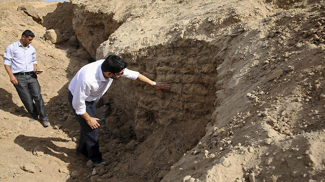 Junaid Sorosh-Wali, a UNESCO official, inspects damage at Tel Es-Sakan hill  (Photo: AP)