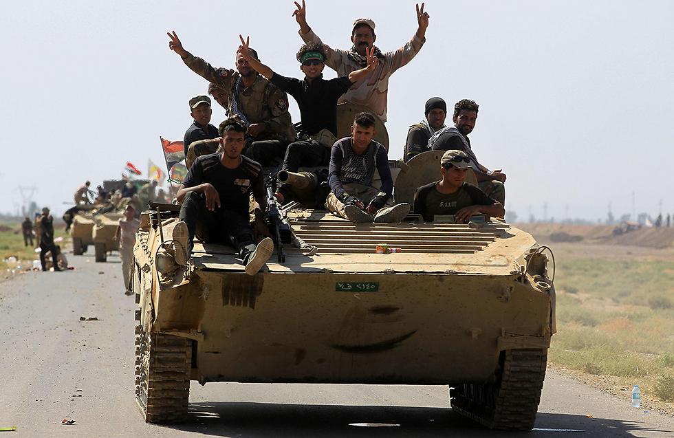 כוחות צבא עיראק בעיר אל-חוויג'ה שנכבשה מידי דאעש  (צילום: AFP)