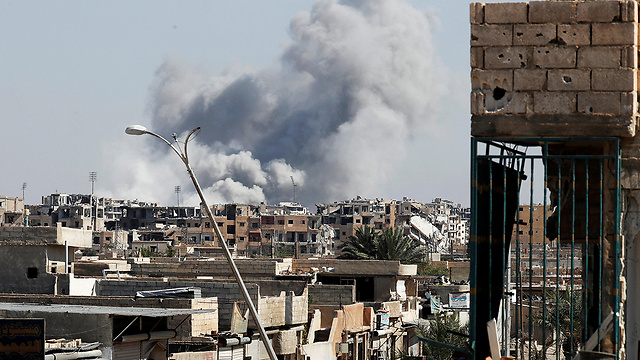 Smoke billowing over the Raqqa municipal stadium (Photo: Reuters)