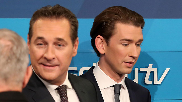 New Chancellor Kurz (R) formed a coalition with Strache's far-right FPO party (Photo: Getty Images)