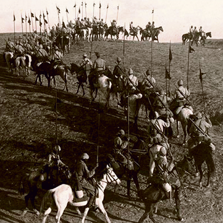Anzacs riding through Be'er Sheva in 1917