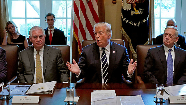 L to R: State Secretary Rex Tillerson, President Donald Trump, Defense Secretary James Mattis (Photo: AFP)