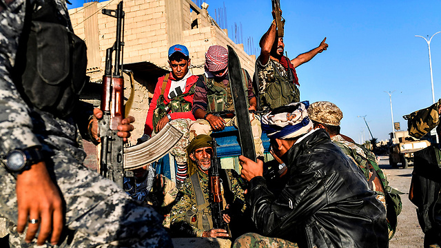 Syrian Democratic Forces fighters celebrate in Raqqa (Photo: AFP)