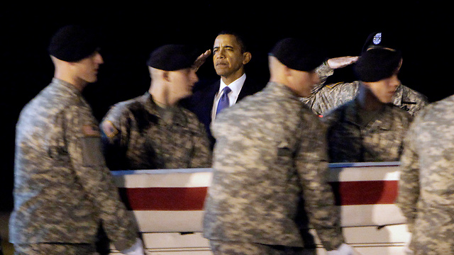 Obama saluting the coffin of Sgt. Dale Griffin, who was killed in action (Photo: AFP)