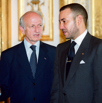 Audrey's father, André Azoulay (L), with King Mohammed VI of Morocco  (Photo: AFP)