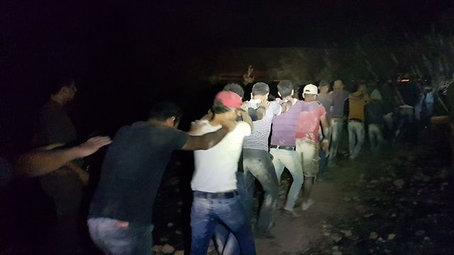 The suspects led by IDF Border Police (Photo: Police Spokesperson's Unit)