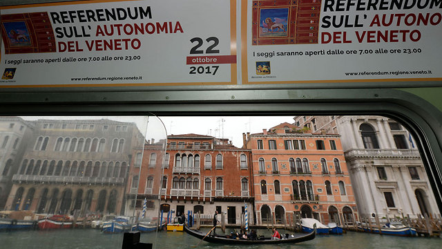 Advertisements announcing the referendum in Venice (Photo: AFP)