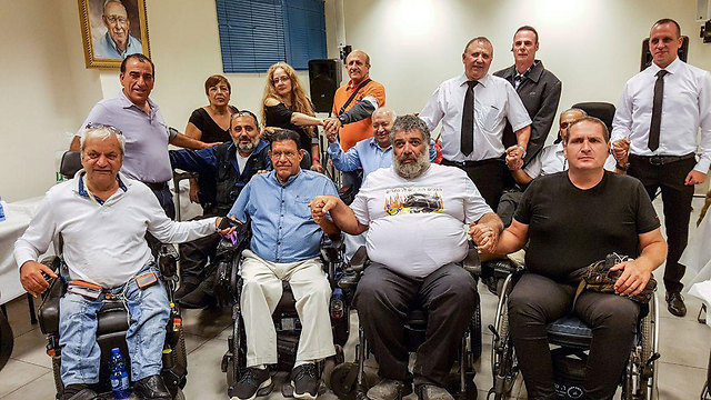 Disabled representatives at Sunday's press conference threatened to shut down Israel's main airport (Photo: Ido Erez)