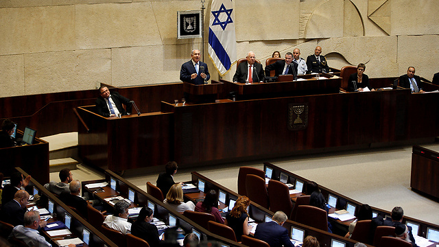 Netanyahu addressing the Knesset, last week. Corruption has reached the Knesset, and this time it's no longer in the form of 'errant weeds'   (Photo: Reuters)