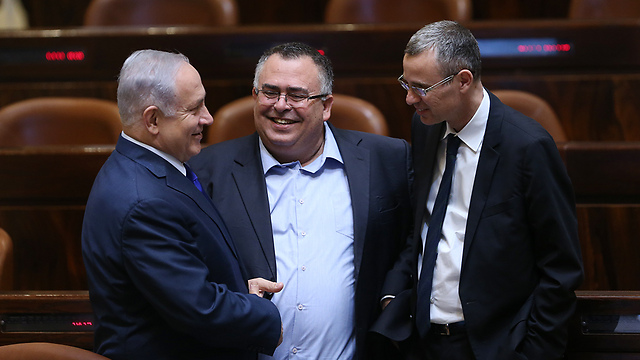 Netanyahu with Coalition Chairman David Bitan (center) and Tourism Minister Yariv Levin. Instead of demonstrating leadership and putting the national interest before any personal interest, the prime minister is setting his yes men on everyone    (Photo: Alex Kolomoisky)