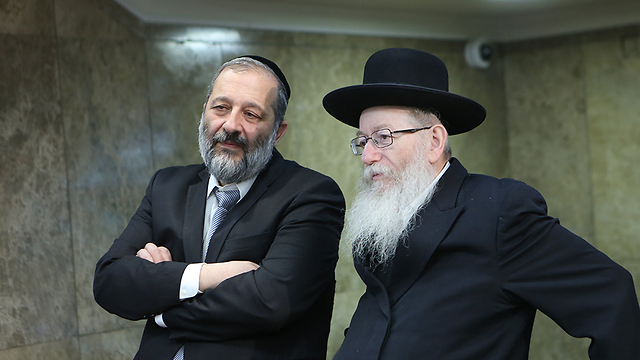 Aryeh Deri (L) and Yaakov Litzman (Photo: Alex Kolomoisky)