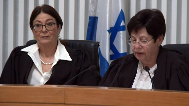 Outgoing Chief Justice Naor (R) read her final verdict, flanked by new Chief Justice Hayut (Photo: GPO)