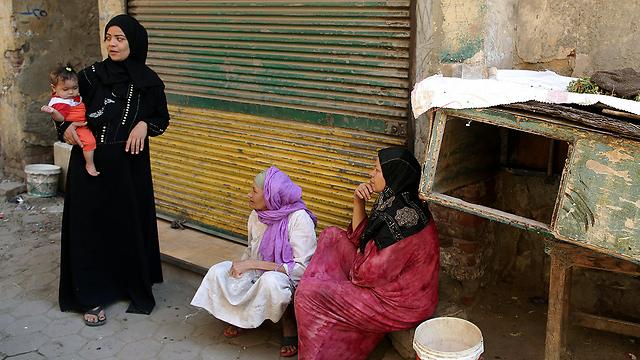 """""""זו לא האמונה, זה הרצון להיטמע"""". מצרים (צילום: EPA) (צילום: EPA)"""