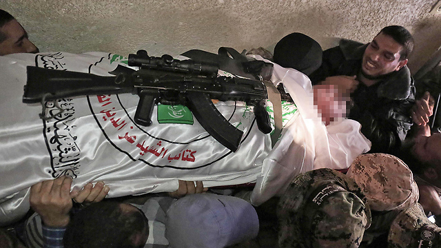 One of the militants killed in the explosion carried off to be buried (Photo: AFP)