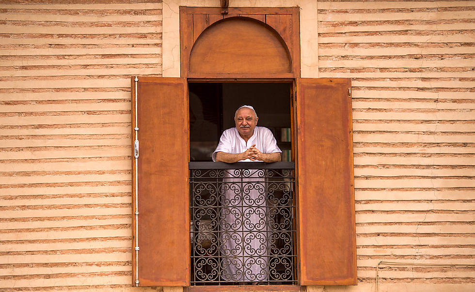 A Moroccan Jewish man looks out his window at the street below from his house in the 'mellah' Jewish quarter of the Medina in Marrakesh (Photo: AFP)