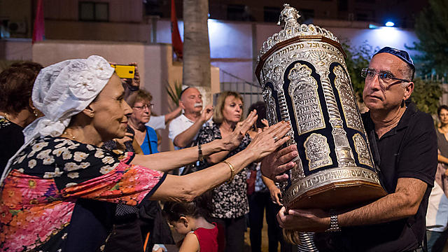 Moroccan Jews and Israeli Jewish tourists participate in Simchat Torah festivities at a synagogue in Marrakesh  (Photo: AFP)