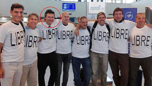Five of eight men pictured in photo, including Jewish businessman Erlij (circled), were killed in the attack
