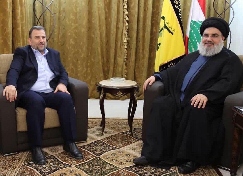 Hamas Deputy Chairman Saleh al-Arouri (L) with Hezbollah Secretary-General Hassan Nasrallah